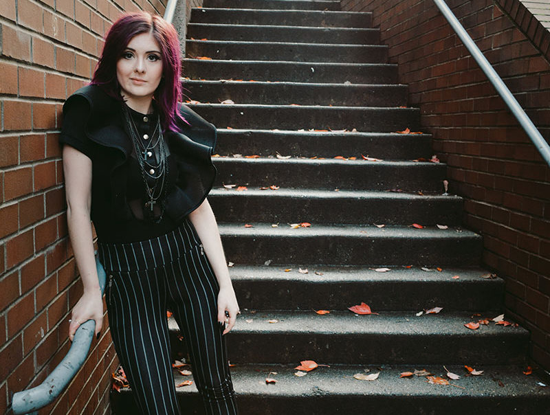Photo of Bethany Stobbe standing in front of stairs
