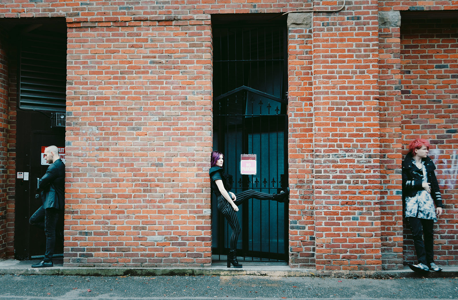 Wade Britz, Bethany Stobbe, and Trevor Stobbe in doorways posing